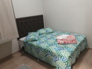 A bed or beds in a room at Pousada da Família
