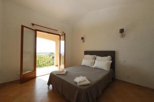 Кровать или кровати в номере Residence Monte Cristo