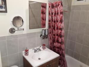 A bathroom at Studio and 1 Bedroom Apartments - Bronx