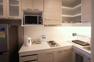 A kitchen or kitchenette at Kannas Serviced Apartment