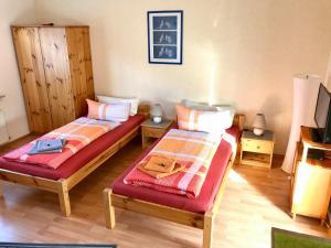 Ein Bett oder Betten in einem Zimmer der Unterkunft Abelia Apartment
