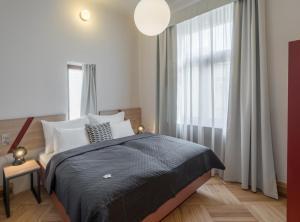 Кровать или кровати в номере The Art House