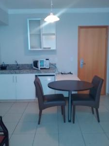 A kitchen or kitchenette at Águas da Serra apart