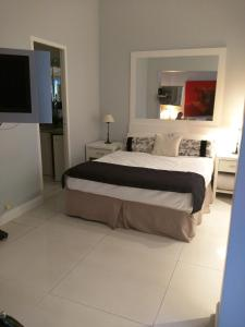 Una cama o camas en una habitación de Recoleta Classic