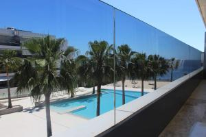 The swimming pool at or near Royal Beach Luxury Apartments