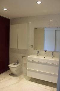 A bathroom at Royal Beach Luxury Apartments