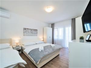 Postel nebo postele na pokoji v ubytování The Majestic VIEW