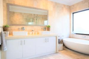 A bathroom at Ocean Breeze - Sunset Beach
