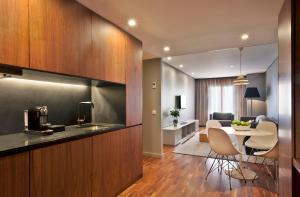 A kitchen or kitchenette at Altis Prime Hotel