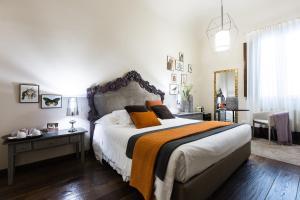 Uma cama ou camas num quarto em Canto degli Scali