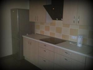 A kitchen or kitchenette at Marijonu Apartments