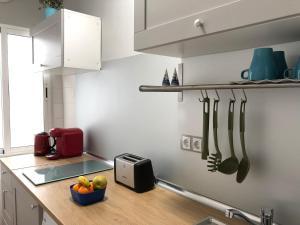 A kitchen or kitchenette at Apartamento Santa Justa