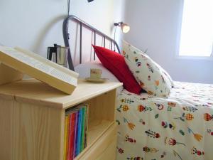 A bed or beds in a room at Casa El Muellito