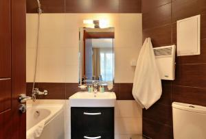 Salle de bains dans l'établissement Apart Hotel Golden Line