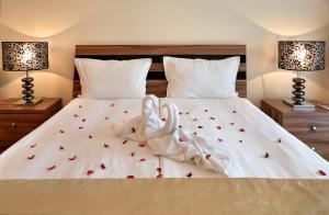 Un ou plusieurs lits dans un hébergement de l'établissement Apart Hotel Golden Line
