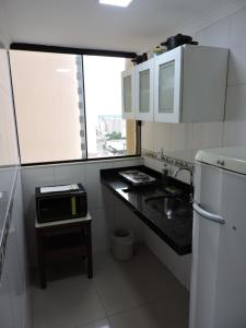 A kitchen or kitchenette at Apartamentos La Residence