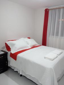 A bed or beds in a room at Guatemala Home Renting