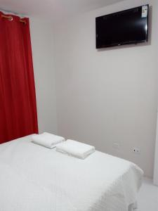 A television and/or entertainment center at Guatemala Home Renting