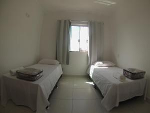A bed or beds in a room at Apartamento em Capitolio