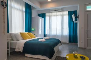 A bed or beds in a room at SUN studio apartments