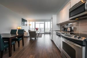 A kitchen or kitchenette at Sweet Condo Downtown with Parking