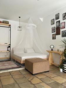 Un ou plusieurs lits dans un hébergement de l'établissement Port Industrial Studio