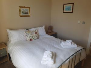 A bed or beds in a room at Ocean View Penthouse Portrush