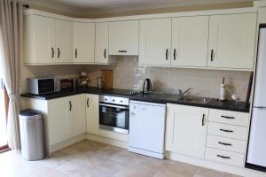A kitchen or kitchenette at Berdie Beach House