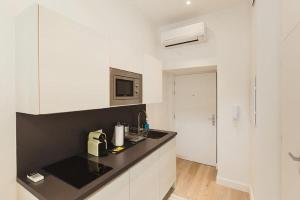 A kitchen or kitchenette at Residence Tonduti