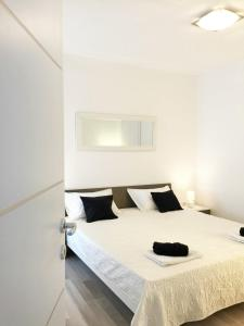 A bed or beds in a room at apartman luce