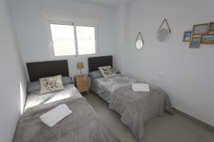 A bed or beds in a room at Apartment La Marina 4863