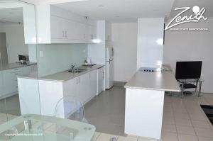 A kitchen or kitchenette at Zenith Ocean Front Apartments