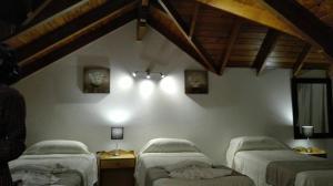 Una cama o camas en una habitación de Cabañas centricas