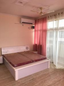 A bed or beds in a room at Sri Vrindavan Dham