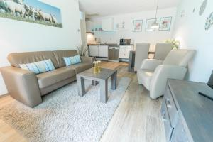 Ein Sitzbereich in der Unterkunft De Pelikaan Texel Appartmenten