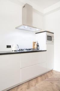 A kitchen or kitchenette at Maison BON Apartment