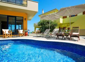 The swimming pool at or near Marelina Villas