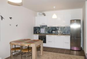 A kitchen or kitchenette at Apartment for 4 people in Prague