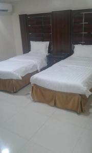 A bed or beds in a room at Qimam Saba Furnished Units (for families only)