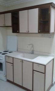 A kitchen or kitchenette at Qimam Saba Furnished Units (for families only)