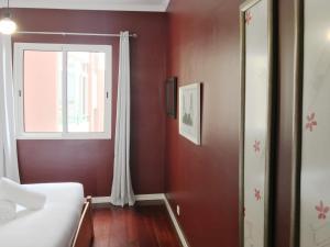 Una televisión o centro de entretenimiento en Ajuda Charming Apartment