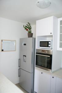 Kuchyň nebo kuchyňský kout v ubytování Apartman Old Town