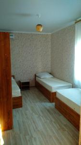 A bed or beds in a room at Уютный домик