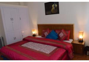 A bed or beds in a room at Olive Green B&B