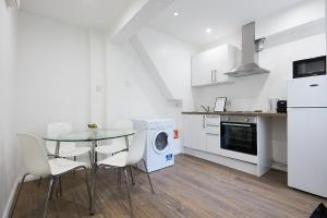 Küche/Küchenzeile in der Unterkunft Charmstay Apartments