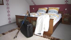 Ein Bett oder Betten in einem Zimmer der Unterkunft Ferienhaus Marienweg