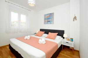 Postel nebo postele na pokoji v ubytování Apartments Town