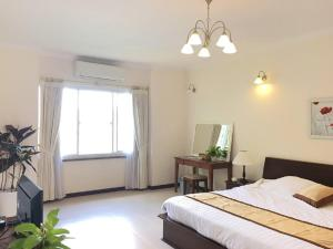 Giường trong phòng chung tại Vietnam Golf - Lake View Villas