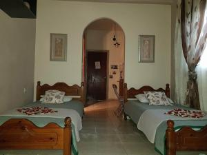 A bed or beds in a room at Villa Kostas