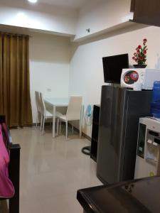 A television and/or entertainment center at Mabolo Garden Great Room